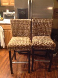 Two rattan barstools 28 inches high from Floor to seat 100.00 for both