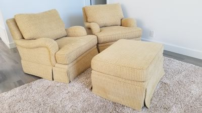 Custom upholstered club chairs with ottoman