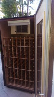 $900, 92 Bottle Glass Door Wine Cabinet