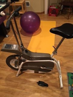 stationary bike weighted wheel