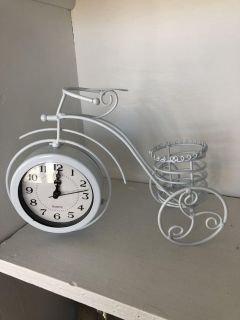 New tricycle clock/candle holder