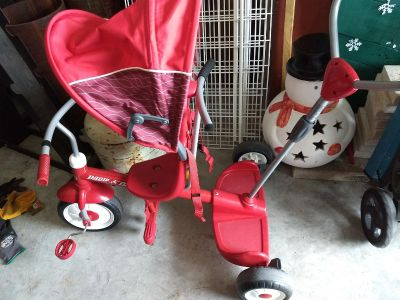 Radio flyer ride and trike bike. Can hold two kids. One standing and one riding!