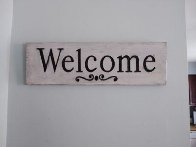Off white wooden welcome sign