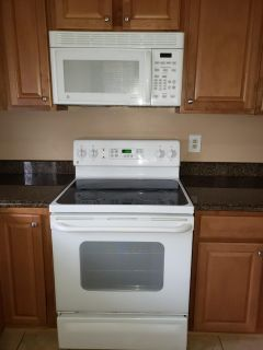 GE Electric stove and overhead microwave