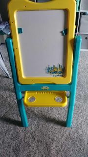 Art easel. Dry erase one side chalk board other. Folds flat. Has clips to hold paper for drawing on dry erase side