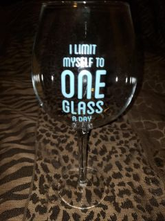 Wine glass-fits a whole bottle of wine.