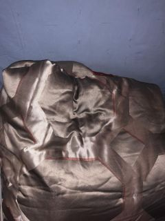 Full size comforter reversible with matching bed skirt excellent condition