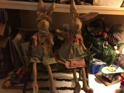 Stuffed fabric boy and girl bunnies and willow bench