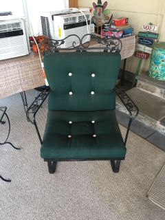Wrought iron chair with heavy green cushion. No tears or stains. Hardly used.
