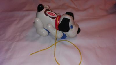 Playskool brand dog pull toy with wheels makes noise when string is pulled can be turned off so that does not make noise