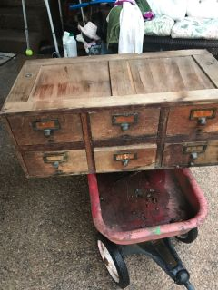Antique file cabinet with metal shelves.