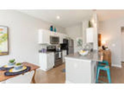 Woodland Acres Townhomes - Two BR, 1.5 BA Townhome 1,156-1,160 sq. ft.
