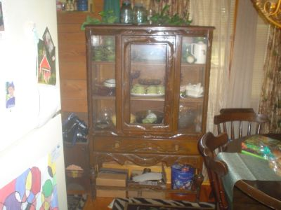 Antique China Cabinet,Trunks,Love Seat, and Good sewing machine