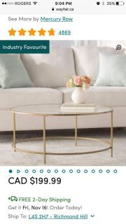 Round glass coffee table from Wayfair