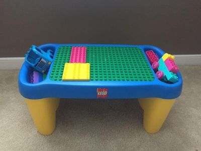Lego table with tons of Legos