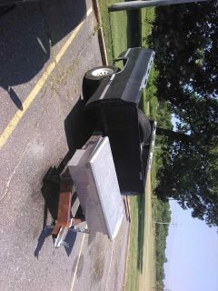 Trailer has spare wheel I have had 3500 pounds on this trailer several times the Jack handle is broken it will do your job
