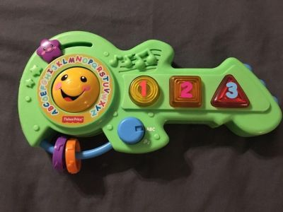 Fisher Price green guitar - plays music numbers and alphabet