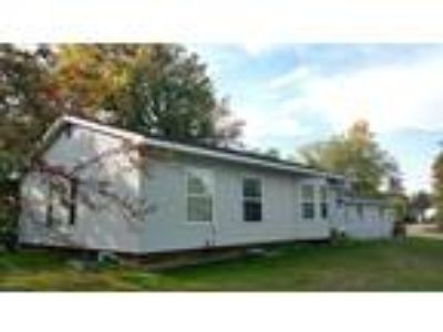 Solid, energy efficient Four BR Three BA home in great location!