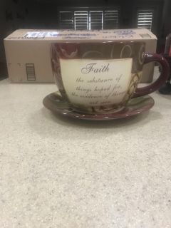 Large coffee mug and saucer. Used for large utensil holder.