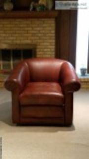 Two Leather Swivel Sofa Chairs