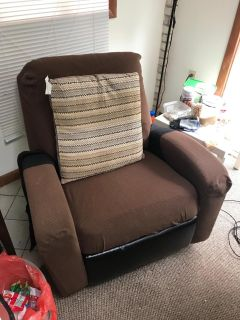 Black lazy chair with brown cover