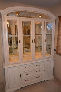 Antique white two piece triple Keller hutch.