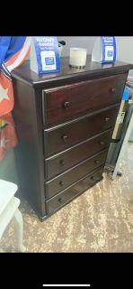 Dark brown wooden 5- drawer chest