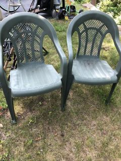 Plastic chairs, camping chairs, and table