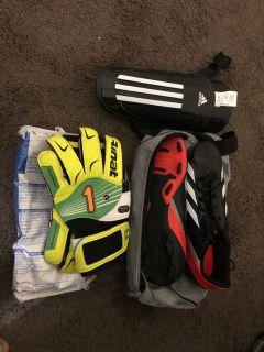 Soccer cleats size 11 goalie gloves and shin guard