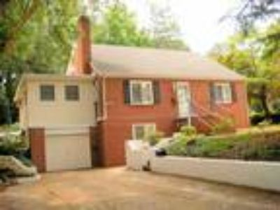 Near NCSU - Exceptional Four BR Two BA All Brick 2,000 Sq. Ft. House.