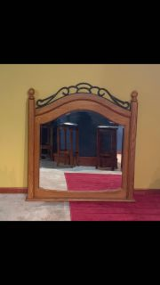 Heavy wooden frame and metal accent mirror