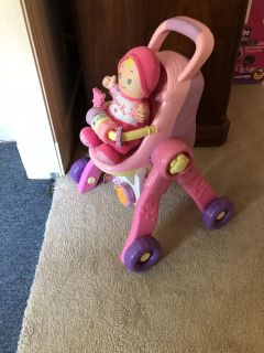 Push stroller and high chair with baby