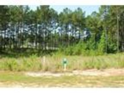 This wooded golf front home site is located i...