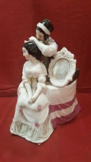 Old Antique Porcelain Figurine. Repaired at neck of girl standing
