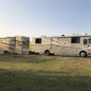 1999 Fleetwood Discovery/2016 Trailer Toad 5000/2011 28' ATC