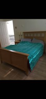 Double bed with two dressers and two night tables