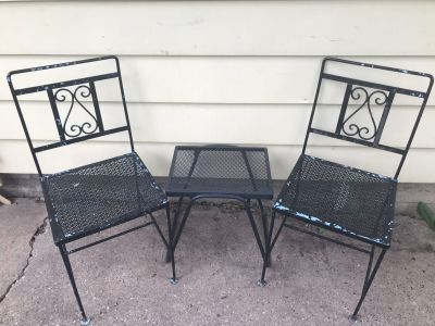 Vintage solid metal chairs and small newer metal table