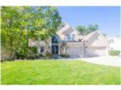 Amazing Location - Four BR Plainfield Custom Home w/ FNSHD Walk Out Basement!