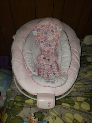 Pink vibrating infant bouncer seat