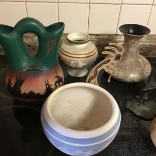 Pottery and two Kokapelli figures sold as a lot $20