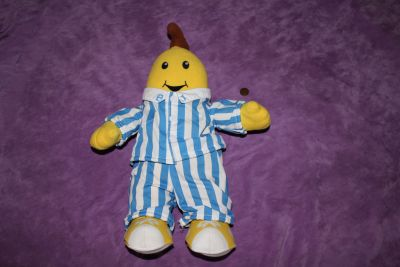 "1995 Tomy 16"" Singing Banana In Pajamas Plush. Small light stain on collar with ""B"""