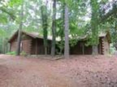 Three BR/@ Bath/2 Garage/ 1756 SF Fully Furnished log home in the woods