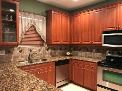 Beautiful upgraded 2 story Townhouse gated community has a screened-in patio.
