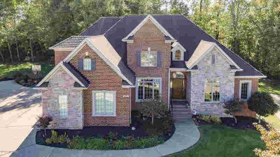 5402 Merribrook Ln Prospect Five BR, Proudly positioned above