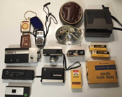 Assortment of cameras film and flash bulbs sold as is
