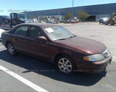 Salvage Maroon 2002 Mazda 626