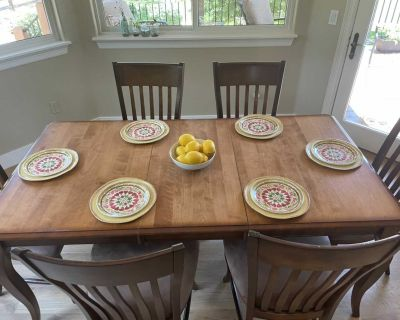 Solid wood table w/ self storage leaf and 6 chairs
