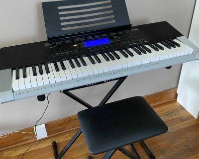 Casio digital keyboard piano with stand and bench