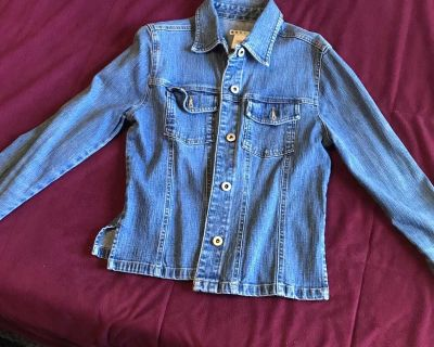 Women s jean jacket size small. Has slits on side. Excellent condition
