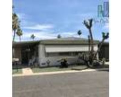 2/2 mobile home for sale in a 55+, pet friendly, golf resort community Lot-96 -